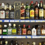 Bottles of alcohol spirits on shelves