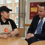 PM speaks with staff member Makeda Sanford about welfare reform